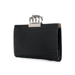 Alexander McQueen jewelled four-ring clutch bag